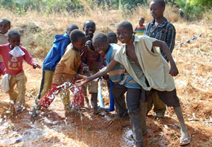 African children playing in water
